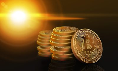 This picture show a couple of bitcoins piled up.