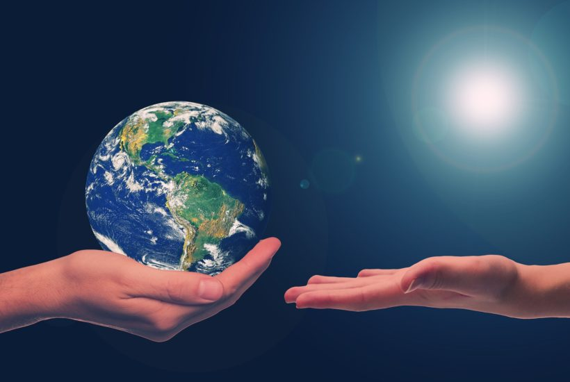 This picture show a person holding the planet earth.