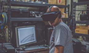 This picture show a man using a VR set.