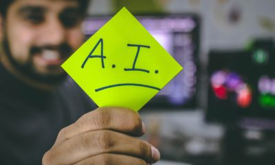 This picture shows a person holding an AI sign.