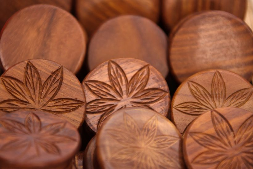 This picture show a couple of cannabis wooden coins.