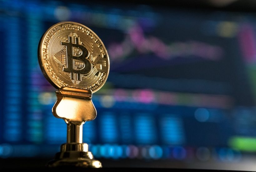 This picture show a bitcoin on a pedestal.