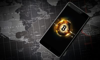 This picture show the bitcoin symbol on a smartphone.