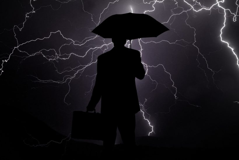 This picture show a person in the middle of a storm.