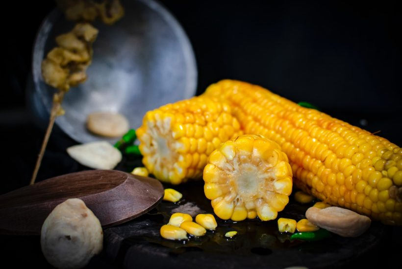This picture show some corn on a table.