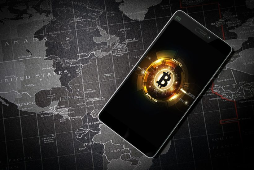 This picture show the bitcoin logo on a smartphone screen.