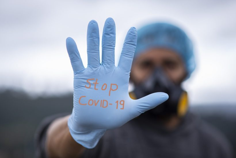 This picture show a doctor with a message in his gloves.
