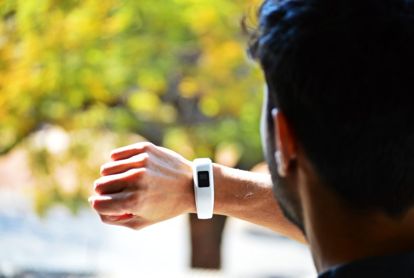 This picture show a person wearing a fitness tracker.