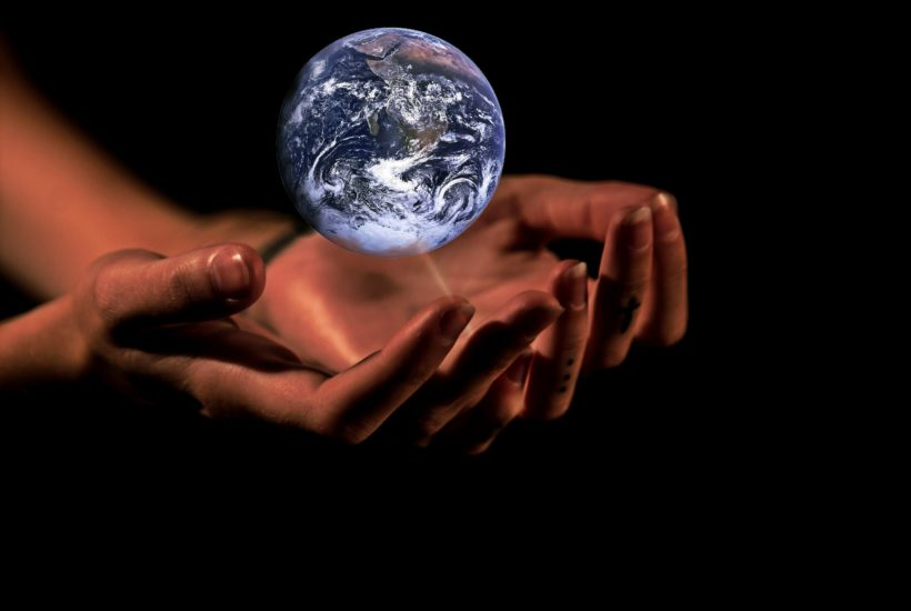 This picture show two hands holding a globe.
