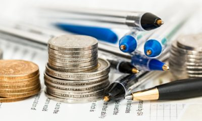 This picture show some coins and pens.