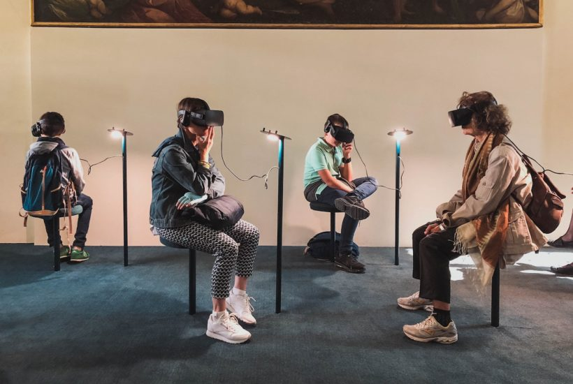 This picture show a group of people using VR sets.