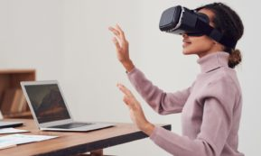 This picture show a woman using virtual reality.