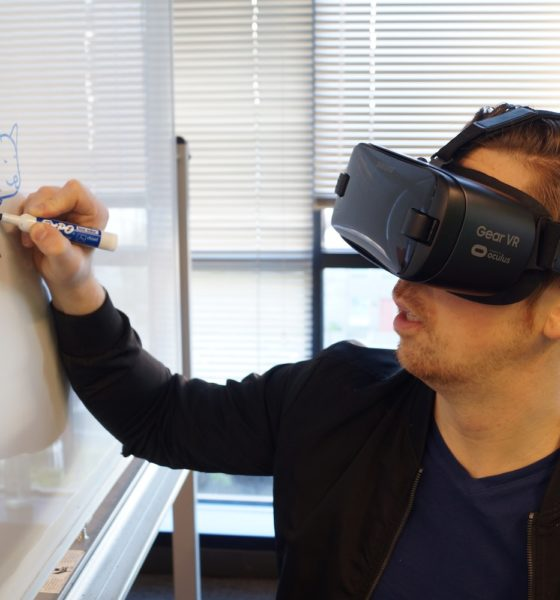 This picture show some writing on a board with a VR set.