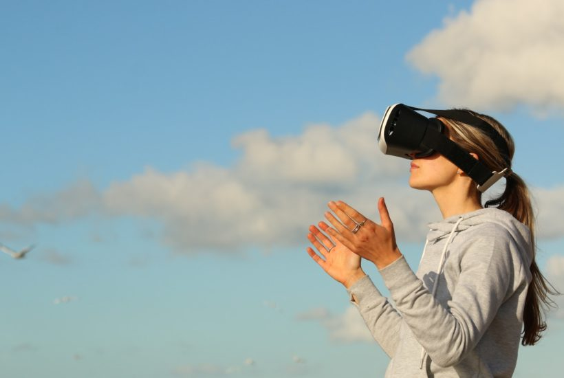 This picture show a woman using a VR set.