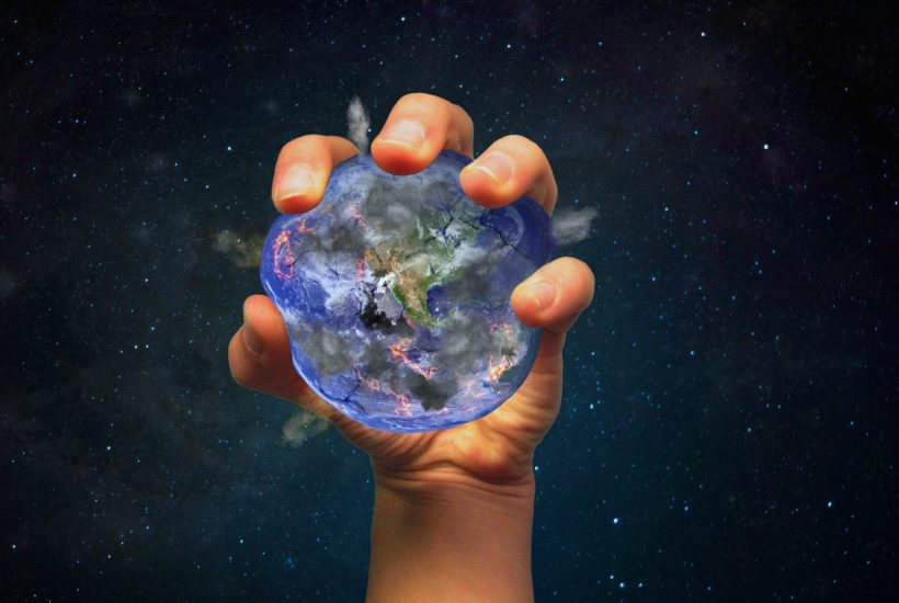 This picture show a persona holding the planet earth.