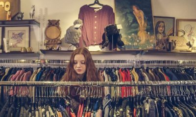 This picture show a girl looking at clothes.
