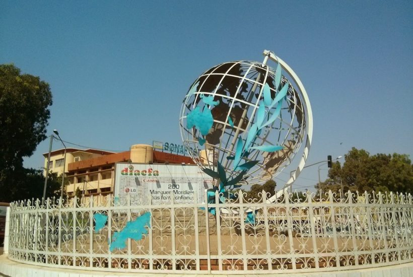 This picture show a globe monument.