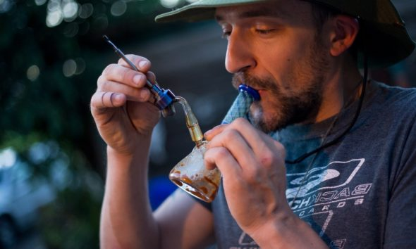 This picture show a person smoking cannabis.