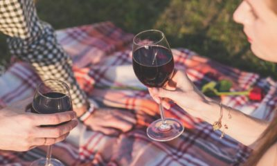 This picture show two people drinking wine.