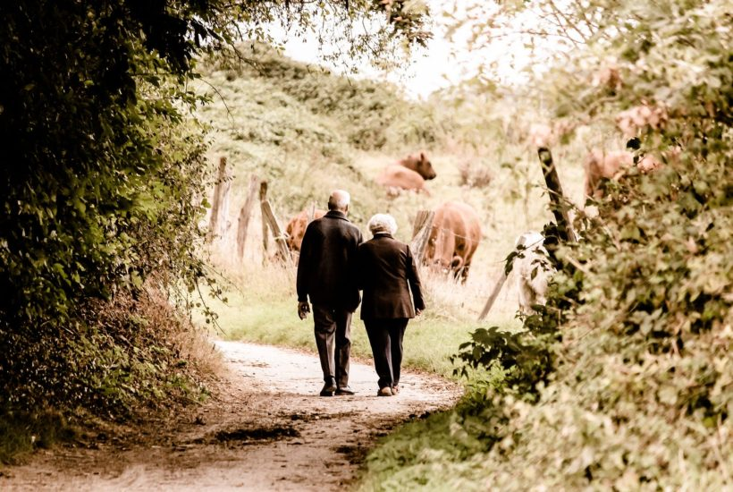 This picture show and old couple walking.
