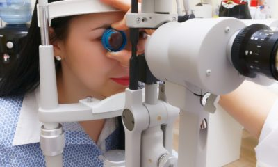 This picture show a person doing an eye exam.
