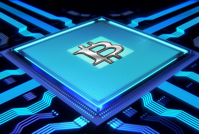 This picture show a chip with the bitcoin logo.