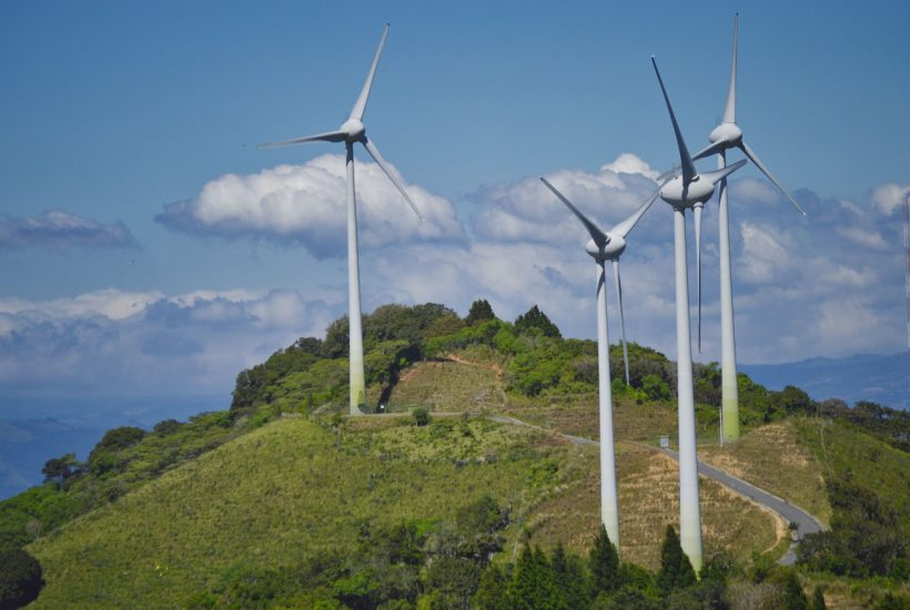 This picture show a couple of wind turbines.