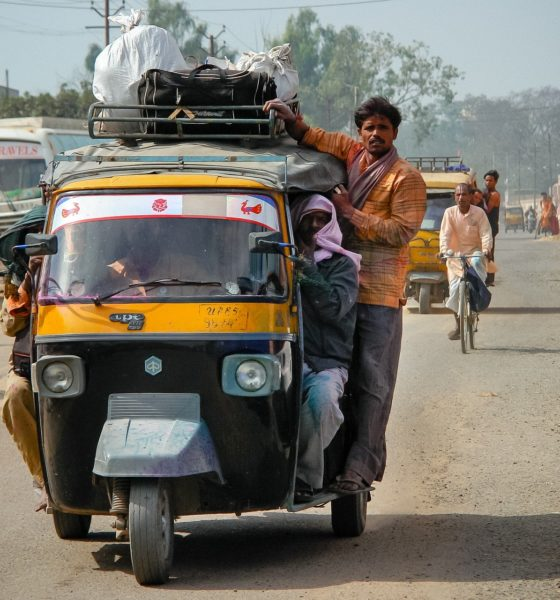 This picture show a person on a car in India.