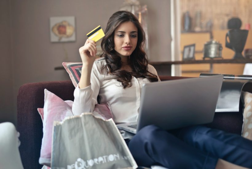 This picture show a woman using a credit card.
