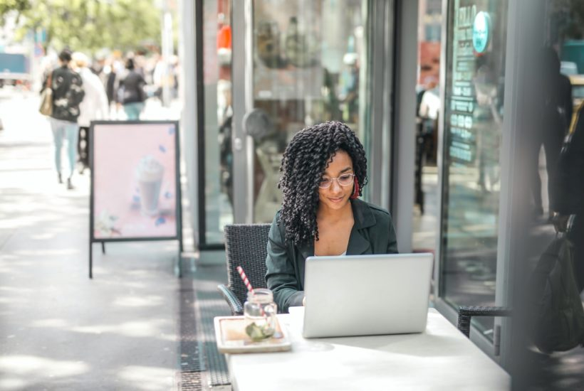 This picture show a woman using a laptop.