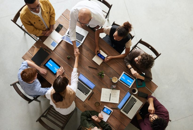 This picture show a group of people in a meeting.
