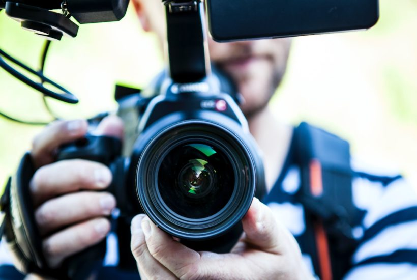This picture show a person with a video camera.