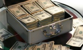 This picture show a suitcase full of dollars.