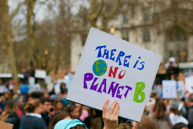 This picture show a group of people during a climate protest.