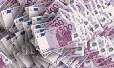 This picture show a lot of Euro bills.