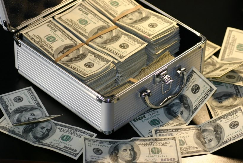 This picture show a case full of dollar bills.