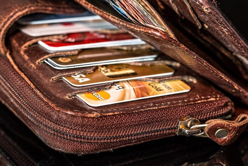 This picture show a wallet with some credit cards.