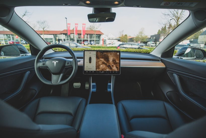 This picture show the cabin of a Tesla car.