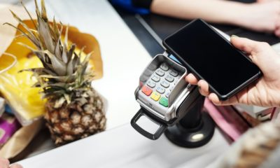 This picture show a person making a payment.